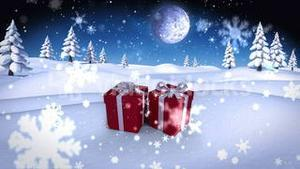 Snow falling on christmas presents in snowy landscape