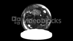 Snow globe on black background with alpha channel