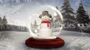 Snowman waving inside snow globe