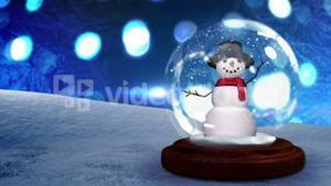Snow man waving inside snow globe