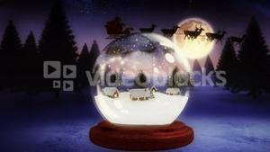 Christmas village inside snow globe with flying santa