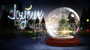 Christmas tree inside snow globe with magic greeting in french