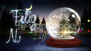 Christmas tree inside snow globe with magic greeting in spanish