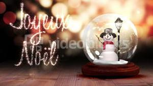 Snowman inside snow globe with magic greeting in french