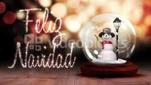 Snowman inside snow globe with christmas greeting in spanish