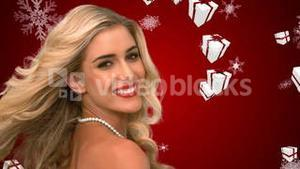 Glamorous blonde tossing hair against falling christmas gifts