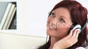 Relaxed woman with headphones on a sofa