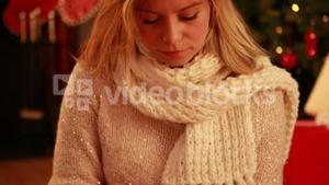 Pretty blonde using tablet at christmas
