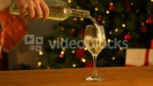 Hand pouring a glass of wine