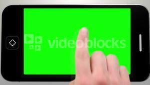 Hand using smartphone with green screen