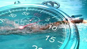 Stopwatch graphic over swimmer in slow motion