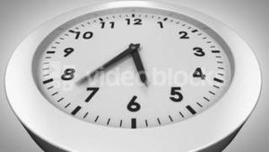 Clock ticking on white background