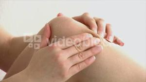 Close up of a woman with knee pain