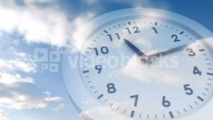 Ticking clock over blue sky