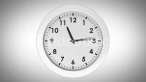 Ticking clock on white background