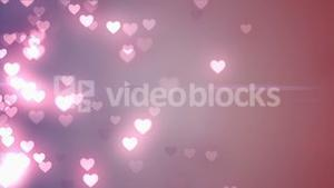 Glittering hearts on pink background