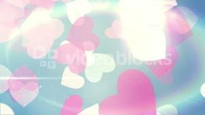 Glittering hearts on blue background