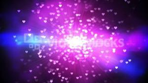 Purple shimmering hearts on black background