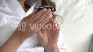 Close up of a hispanic woman writing a text message on her cellphone