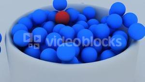 3d animation of balls falling down into a cup