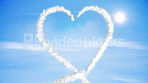 Clouds forming heart shape in sky