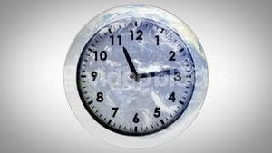 Clock ticking against the earth