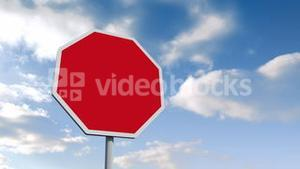 Empty red road sign over cloudy sky