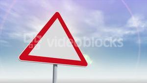 Red and white road sign against changing sky