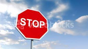 STOP road sign over cloudy sky