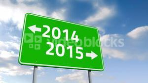 2014 and 2015 road sign over cloudy sky