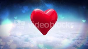 Red heart turning over blue sky