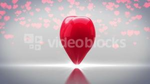 Red heart turning and exploding on grey background