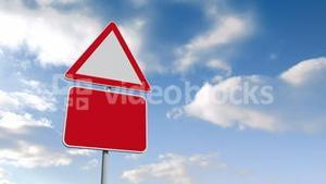 Road signs against blue sky