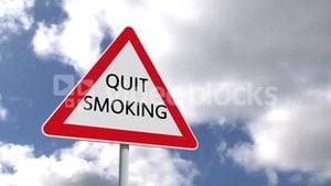 Quit smoking sign against blue sky