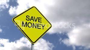 Save money sign against blue sky