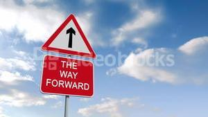The way forward sign against blue sky