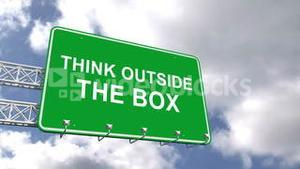 Think outside the box sign against blue sky