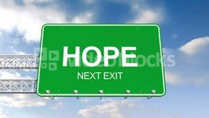 Hope next exit sign against blue sky