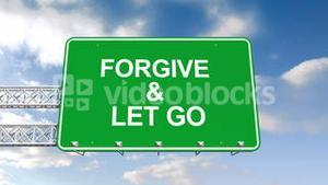 Forgive and let go sign against blue sky