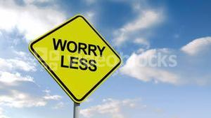Worry less sign against blue sky