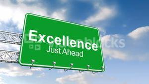 Excellence just ahead sign against blue sky