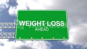 Weight loss ahead sign against blue sky
