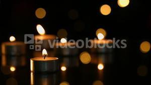 Small candles burning brightly