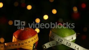 Apples wrapped in measuring tape