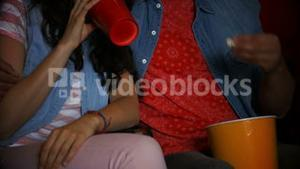 Couple watching 3d movie in cinema