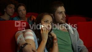 Friends watching sad movie in cinema