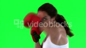 Athletic woman practicing boxe