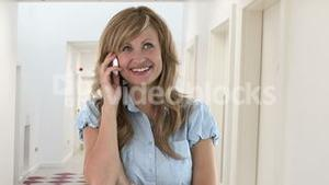 Blond young woman talking on the phone