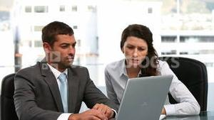 Businesswoman and a businessman working together