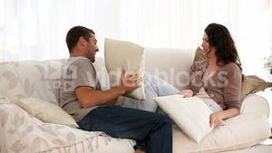 Man and woman doing a cushion figh